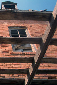 Bricks and rafters on an old mill, near sunset